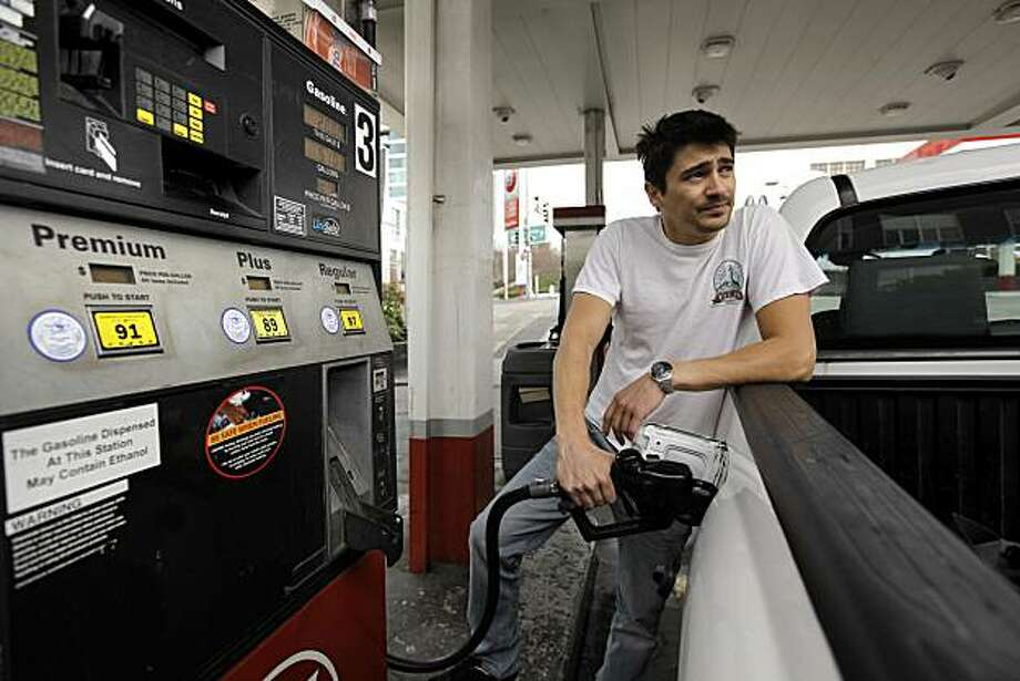 "Andre Manzoni, a pizza delivery man from San Francisco, puts $20 worth of gasoline into his pick up truck, on Thursday Feb. 24, 2011, at the 76 Station at 1st and Harrison Streets, in San Francisco, Ca.,  where premium is selling for $4.15 a gallon. The revolutions sweeping the Middle East hasve already seen the return of $4 gasoline to Bay area gas stations. The state's average has hit $3.60, up 10 cents in the last week alone. Turmoil in the arab world isn't the only reason for the price spike. Every year at this time, California refineries go through a process called ""turnaround, "" when they ramp down production, perform maintenance, and switch to making summer-grade gasoline. Photo: Michael Macor, The Chronicle"