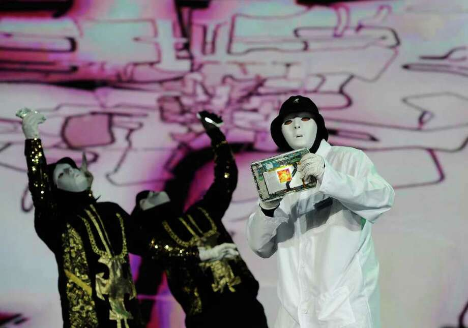 LAS VEGAS, NV - JANUARY 10:  Members of the JabbaWockeez dance crew perform holding a tablet with the Qualcomm Snapdrogan processor during a keynote address by Chairman and CEO Dr. Paul E. Jacobs of Qualcomm at the 2012 International Consumer Electronics Show at The Venetian on January 10, 2012 in Las Vegas, Nevada. CES, the world's largest annual consumer technology trade show, runs through January 13 and is expected to feature 2,700 exhibitors showing off their latest products and services to about 140,000 attendees. Photo: Kevork Djansezian, Getty Images / 2012 Getty Images