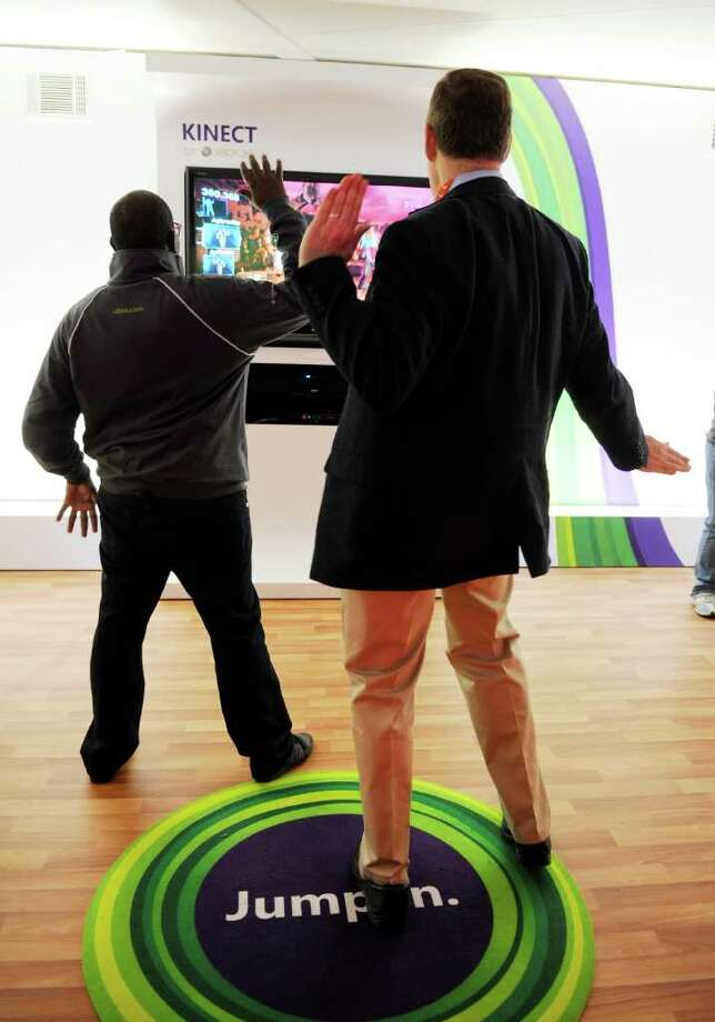 LAS VEGAS, NV - JANUARY 10:  Microsoft representative Derrick Stanfield Kivoi (L) and Bernard Groveman dance to Microsoft's Xbox 360's 'Dance Central 2' using the Kinect at the 2012 International Consumer Electronics Show at the Las Vegas Convention Center January 10, 2012 in Las Vegas, Nevada. CES, the world's largest annual consumer technology trade show, runs through January 13 and is expected to feature 2,700 exhibitors showing off their latest products and services to about 140,000 attendees. Photo: David Becker, Getty Images / 2012 Getty Images