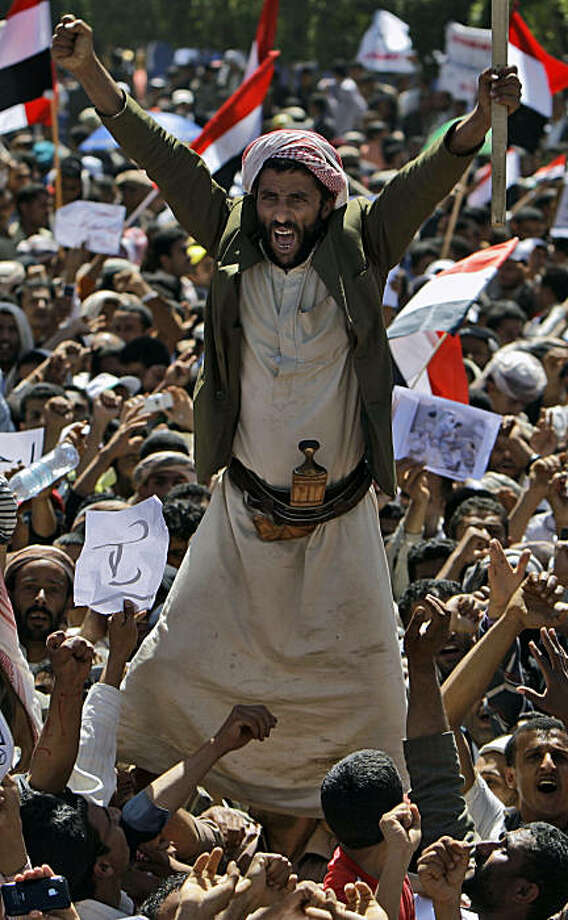 An anti-government protestor reacts as he and other demonstrators shout slogans during a demonstration demanding the resignation of Yemeni President Ali Abdullah Saleh, in Sanaa, Yemen, Tuesday, March 1, 2011.  Yemen's embattled president has accused theUnited States and Israel of trying to destabilize his country and the Arab world. Photo: Muhammed Muheisen, AP