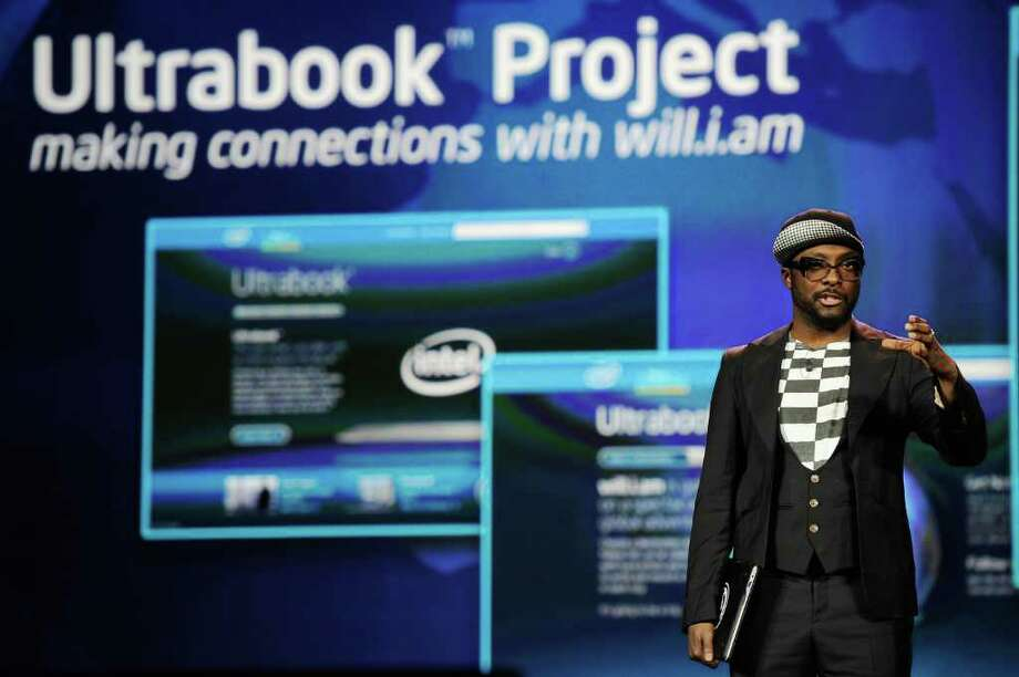 LAS VEGAS, NV - JANUARY 10:  Recording artist and Intel's director of creative innovation will.i.am holds his Intel Ultrabook device during Intel's presentation at the 2012 International Consumer Electronics Show at The Venitian on January 10, 2012 in Las Vegas, Nevada. CES, the world's largest annual consumer technology trade show, runs through January 13 and is expected to feature 2,700 exhibitors showing off their latest products and services to about 140,000 attendees. Photo: Kevork Djansezian, Getty Images / 2012 Getty Images