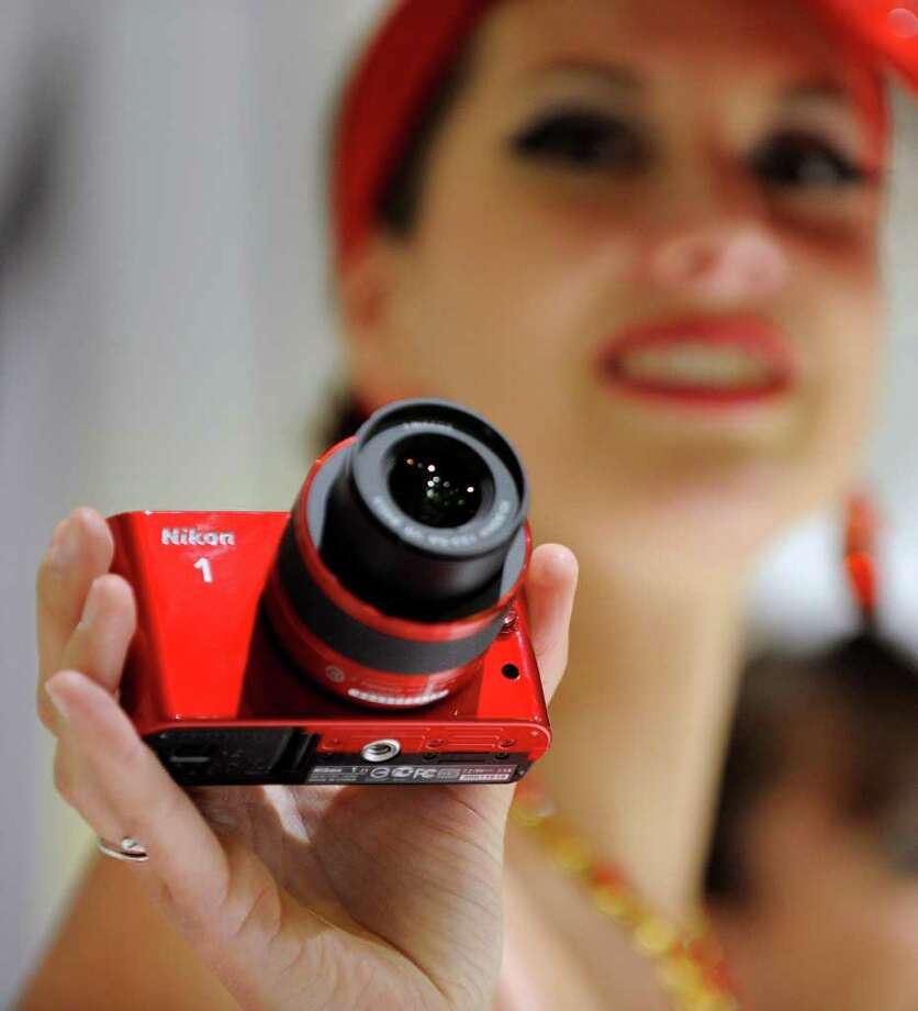LAS VEGAS, NV - JANUARY 10:  A model displays the Nikon 1 camera at the Nikon booth at the 2012 International Consumer Electronics Show at the Las Vegas Convention Center January 10, 2012 in Las Vegas, Nevada. CES, the world's largest annual consumer technology trade show, runs through January 13 and is expected to feature 2,700 exhibitors showing off their latest products and services to about 140,000 attendees. Photo: David Becker, Getty Images / 2012 Getty Images