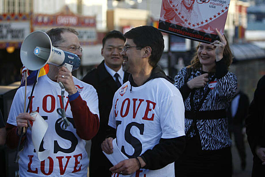 John Lewis (left, with megaphone) and partner of twenty four years Stuart Gaffney (right), both members of Marriage Equality USA, speak at the celebration of the US Justice department's decision to drop its defense of the federal Defense of Marriage Act on Wednesday February 23, 2011. Photo: Anna Vignet, The Chronicle