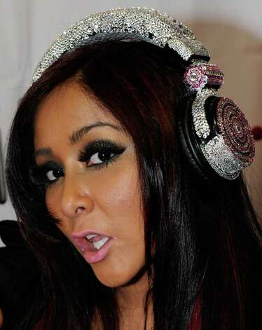 "LAS VEGAS, NV - JANUARY 10:  Television personality Nicole ""Snooki"" Polizzi appears during an autograph signing at iHip's booth at the 2012 International Consumer Electronics Show at the Las Vegas Convention Center January 10, 2012 in Las Vegas, Nevada. CES, the world's largest annual consumer technology trade show, runs through January 13 and is expected to feature 2,700 exhibitors showing off their latest products and services to about 140,000 attendees. Photo: Ethan Miller, Getty Images / 2012 Getty Images"