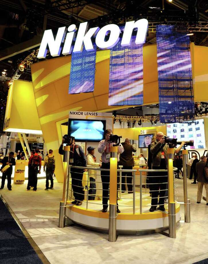 LAS VEGAS, NV - JANUARY 11:  A general view of the Nikon booth at the 2012 International Consumer Electronics Show at the Las Vegas Convention Center January 11, 2012 in Las Vegas, Nevada. CES, the world's largest annual consumer technology trade show, runs through January 13 and features more than 3,100 exhibitors showing off their latest products and services to about 140,000 attendees. Photo: Ethan Miller, Getty Images / 2012 Getty Images