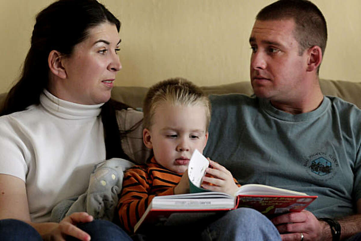 Danah and John Jewett talk among themselves as they read with their son 3 year old son Jayden at their home, Sunday Feb. 27, 2011, in Fairfield, Calif. The first son Dylan died in 2009 at the age of 5 of a brain tumor. They donated the tumor to Stanford scientists who have developed the first animal model of a type of brain cancer, diffuse intrinsic pontine glioma, that only affects young children and is almost always fatal.