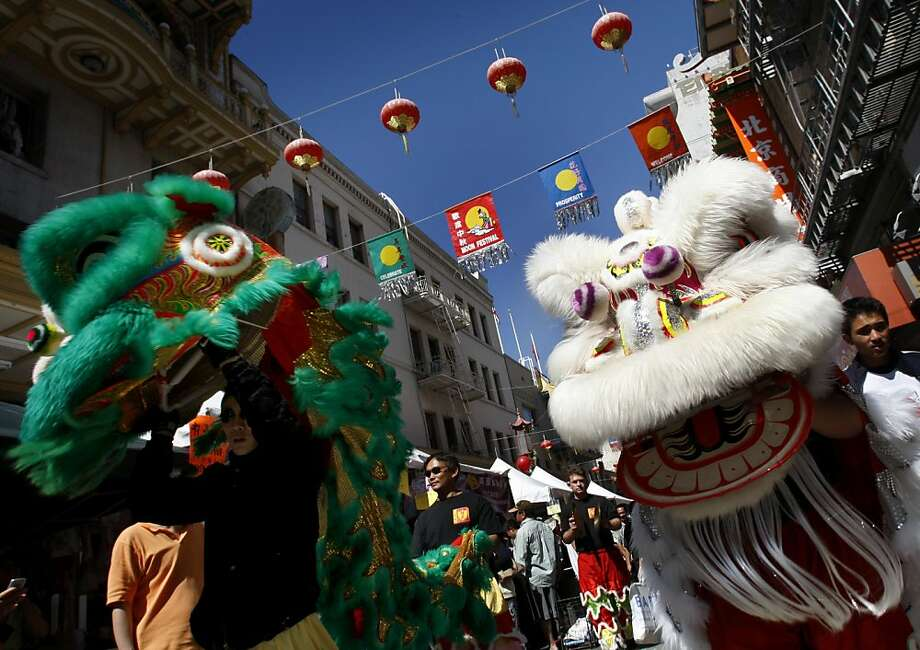Lion dancers from the Jing Mo Athletic Association parade down Grant Avenue in Chinatown during the Autumn Moon Festival celebration in San Francisco, Calif., on Sunday, Sept. 20, 2009. Photo: Paul Chinn, The Chronicle
