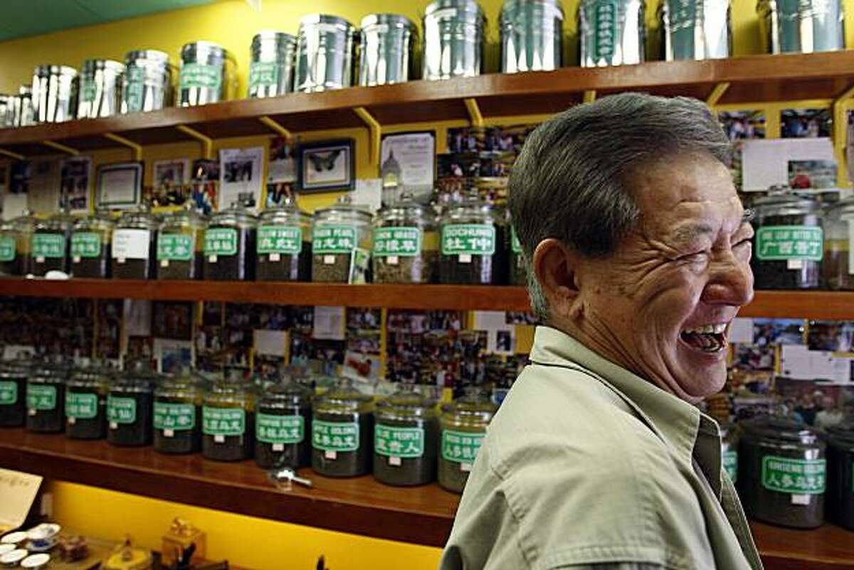 Uncle Gee, who runs the Vital Tea Leaf in San Francisco Chinatown interacts with his customers (mostly tourist) as he passionately preaches the health benefits in drinking tea in San Francisco, Calif., on July 11, 2009.