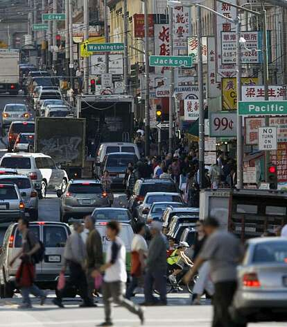 Cars, trucks, buses and pedestrians fight for space on Stockton Street on Tuesday Oct. 7, 2008 in San Francisco, Calif. San Francisco's Chinatown was discovered to be one of the neighborhoods in the city. Photo: Mike Kepka, The Chronicle
