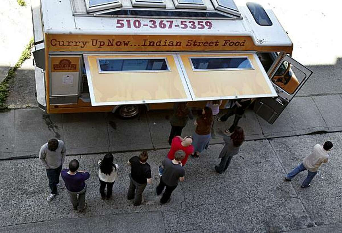 On Sabin Alley near Chinatown in San Francisco, Calif. people line up for their lunch Tuesday June 29, 2010. Mobile food trucks like Curry Up Now rely on Twitter and Facebook to let their customers know where they will be parking and serving food.