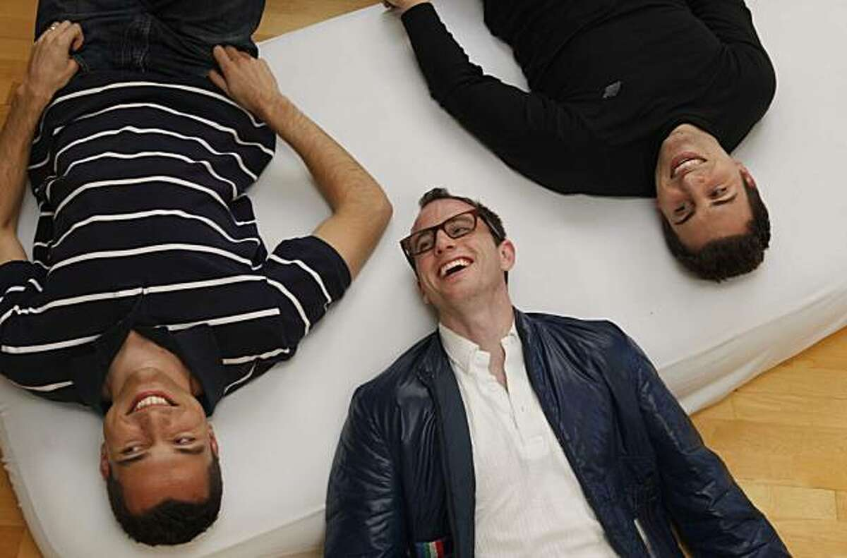 The co-founders of AirBnbB Nathan Blecharczyk, Joe Gebbia and Brian Chesky lie for a portrait on an air bed in their SOMA headquarters on Tuesday March 16, 2010 in San Francisco, Calif. Their company provides an online listing for regular people looking to rent their couch or a spare room to travelers.