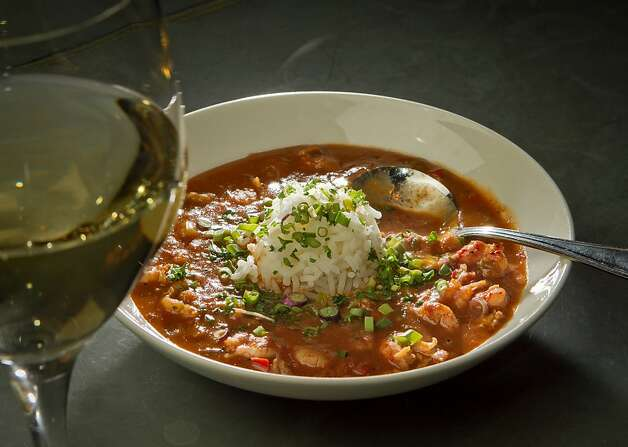 The Crawfish Etouffee with a glass of white wine at the Boxing Room Restaurant in San Francisco, Calif.,  is seen on Wednesday, December 21st,  2011. Photo: John Storey