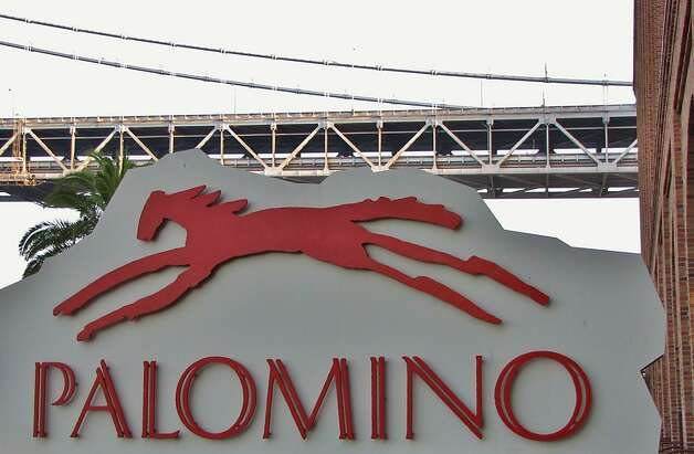 Palomino offers Bay Bridge views, as well as a candied apple drop or cranberry mojito cocktail and Dungeness crab and artichoke dip. Photo: Stephanie Wright Hession