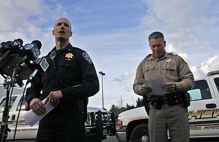 Officer Brian Hill of the Walnut Creek Police Department and Contra Costa Sheriffs Department Lt. Eric Navarro addresses the media Sunday in Concord after Matthew Miller, 16, and Gavin Powell, 17, of Walnut Creek were found dead. Photo: Lacy Atkins, The Chronicle