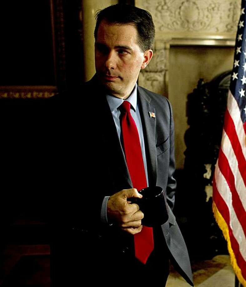 MADISON, WI - FEBRUARY 22:  Wisconsin Governor Scott Walker prepares for his fireside chat at the Wisconsin State Capitol February 22, 2011 in Madison, Wisconsin. With state Democrats still in hiding over the legislation proposed by the Governor to restrict collective bargaining for public workers, Republicans threatened to move on without them in conducting other matters in the state's business. Photo: Pool, Getty Images