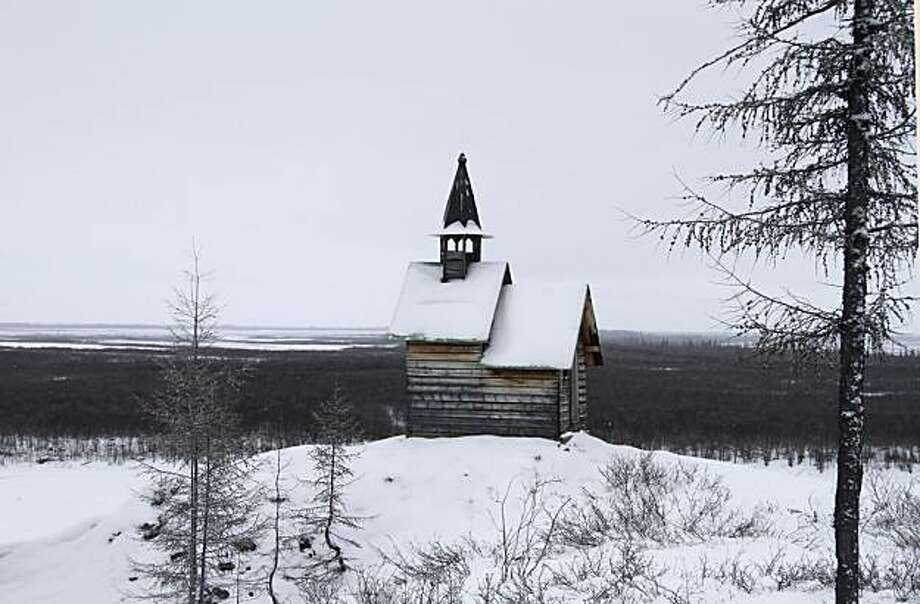 In this Oct. 26, 2010 photo, a tiny chapel is seen on the grounds of the Northeast Science Station near the town of Chersky in Siberia 6,600 kms (4,000 miles) east of Moscow, Russia. Gas locked inside Siberia's frozen soiland under its lakes has been seeping out since the end of the last ice age 10,000 years ago. But in the last few decades, as the Earth has gradually warmed, the icy ground has begun thawing more rapidly, accelerating the release of methane _ a greenhousegas 23 times more powerful than carbon dioxide _ at a perilous rate. Photo: Arthur Max, Associated Press