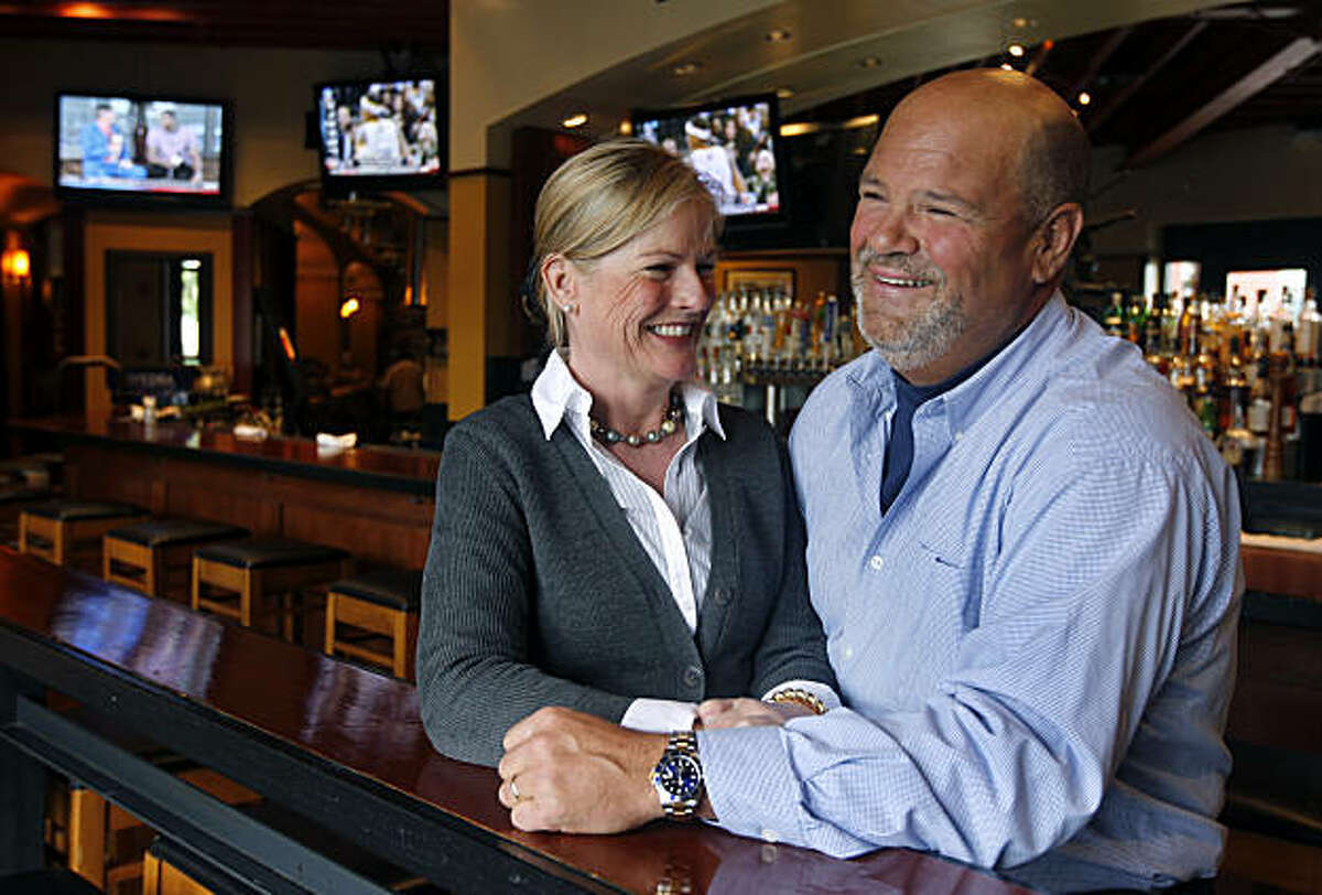 Janet and Peter Osborne relax in the bar of their MoMo's restaurant in San Francisco, Calif., on Friday, Feb. 18, 2011. The Osbornes have helped define the culinary tastes of baseball fans by opening three eateries directly across from AT&T Park.