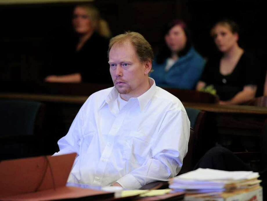 George Mott II sits in Rensselear County Courthouse in Troy, N.Y. Jan. 11, 2012 where he is on trial for the alleged beating death of Rosemary Crosier in 1984.   (Skip Dickstein / Times Union) Photo: SKIP DICKSTEIN / 2011