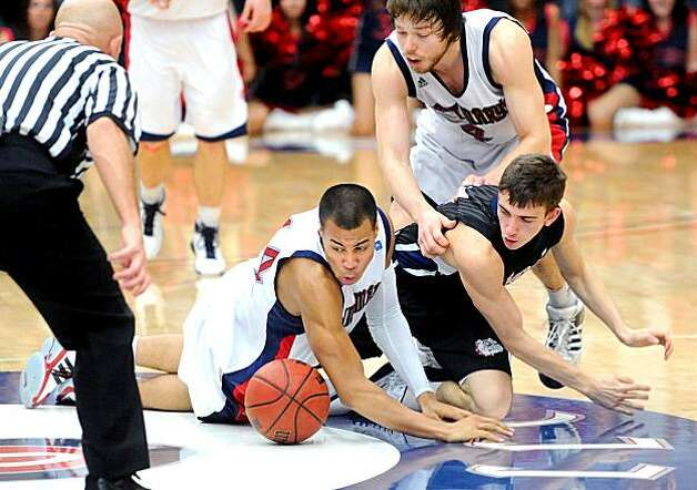 St. Mary's Gaels'  Stephen Holt, left, steals the ball from Gonzaga Bulldogs' David Stockton during overtime onThursday, Feb. 24, 2011, in Moraga, Calif. Photo: Noah Berger, Special To The Chronicle