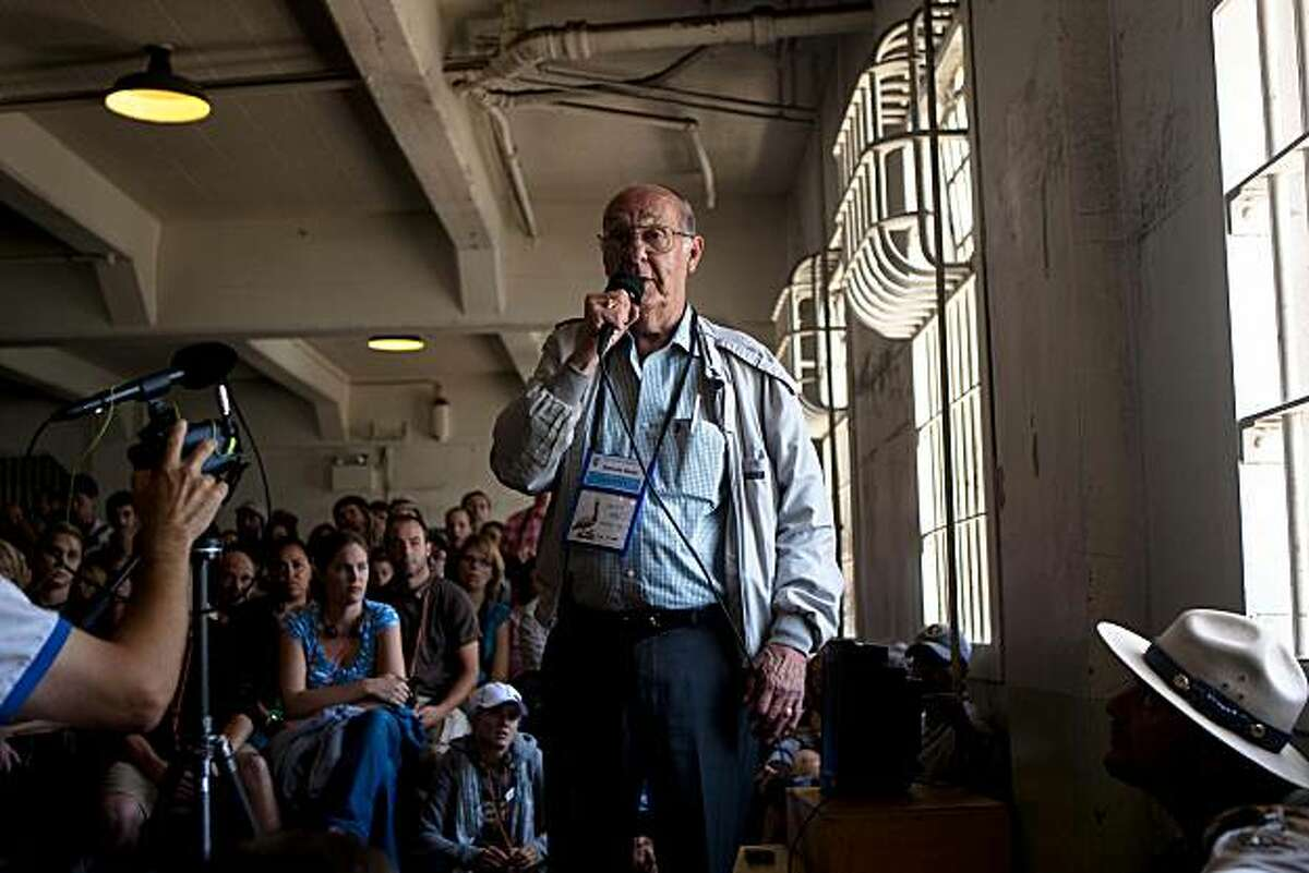 Former convict Darwin Coon speaks to a crowd at the inmate's dining hall during the 75th Anniversary of the opening of U.S. Penitentiary Alcatraz on Alcatraz Island in San Francisco, Calif. on Sunday, Aug. 9, 2009.