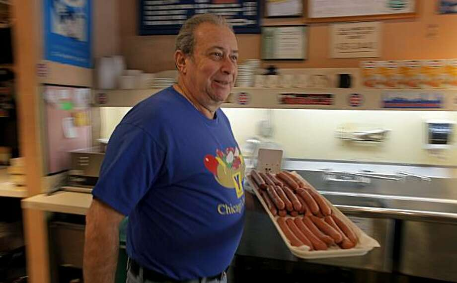 Joe Sattler,  owner of Moishe'e Pippic Deli carries a tray of Vienna hotdogs which is make genuine Chicago Dogs, Tuesday Feb. 22, 2011, in San Francisco, Calif.  Sattler is from Brazil, but wanted to open a Chicago style deli, because New York delis are more common, so he has filled his with Chicago memorabilia most of which came from customers. Photo: Lacy Atkins, The Chronicle
