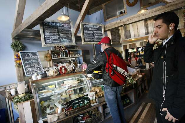 Customers wait for their lunch orders at the Blue Barn Gourmet Deli.  It's a small but cute deli/takeout spot, at 2105 Chestnut St. near Steiner in San Francisco. The facade, which is built to resemble a barn, is carried inside offering a warm cozy feel. Photo: Lance Iversen, SFC