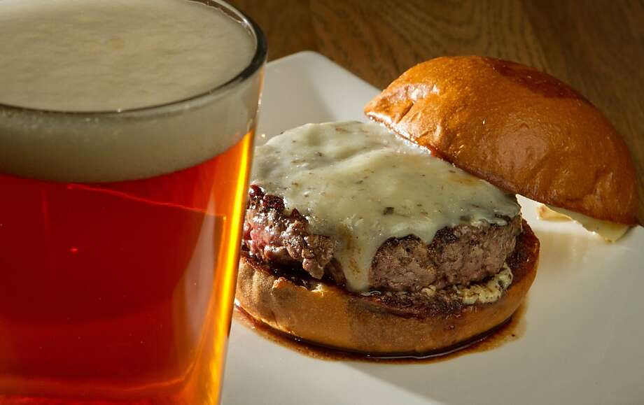 "The ""Truffle"" burger with a beer at Umami Burger in San Francisco, Calif., is seen on Sunday, January 8th,  2012. Photo: John Storey, Special To The Chronicle"