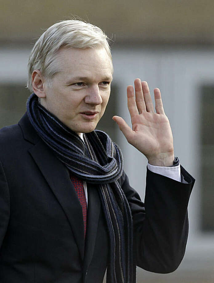 The founder of WikiLeaks Julian Assange waves as he leaves after speaking to the media after his extradition hearing at Belmarsh Magistrates' Court in London, Thursday, Feb. 24, 2011.  Julian Assange can be extradited to Sweden in a sex crimes inquiry, aBritish judge ruled Thursday, rejecting claims by the WikiLeaks founder that he would not face a fair trial there. Assange's lawyer said he would appeal.  Judge Howard Riddle said the allegations of rape and sexual molestation by two women against Assangemeet the definition of extraditable offenses and said the Swedish warrant had been properly issued and was valid. Photo: Matt Dunham, AP