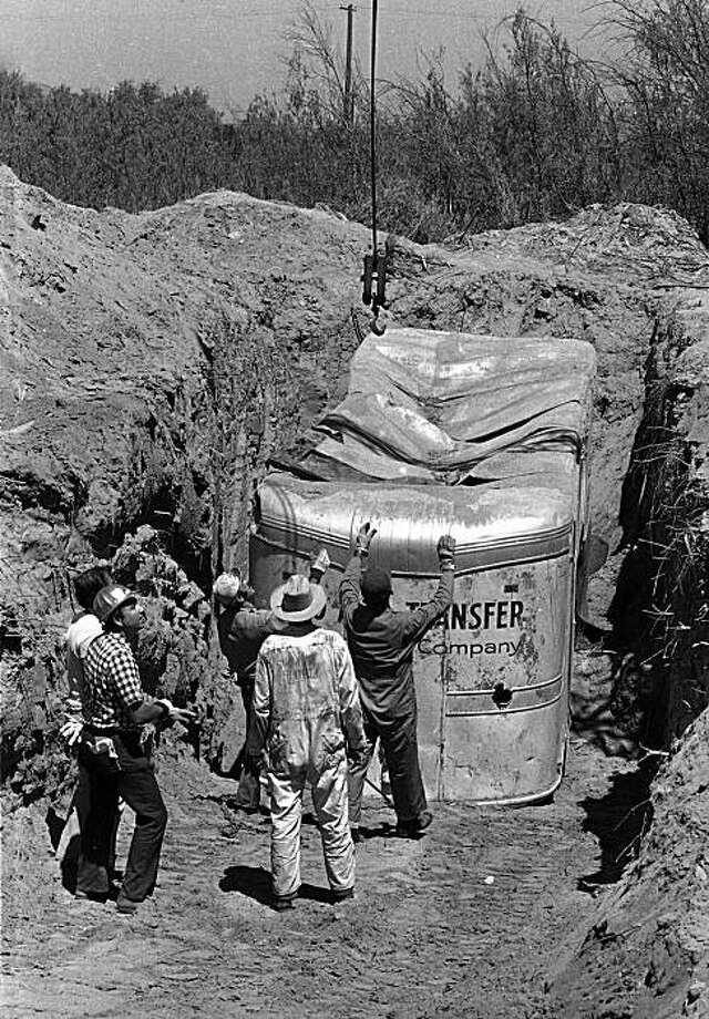 FILE - In this July 20, 1976 file photo, workmen readied a van at a rock quarry in Livermore, Calif.,  in which 26 Chowchilla children and a bus driver were held captive. Three men who kidnapped and hid a busload of California schoolchildren in a 1976 ransom attempt are up for parole again _ and this time, they have the support of the judge, prosecutors and investigators who handled their notorious case. Photo: James Palmer, AP