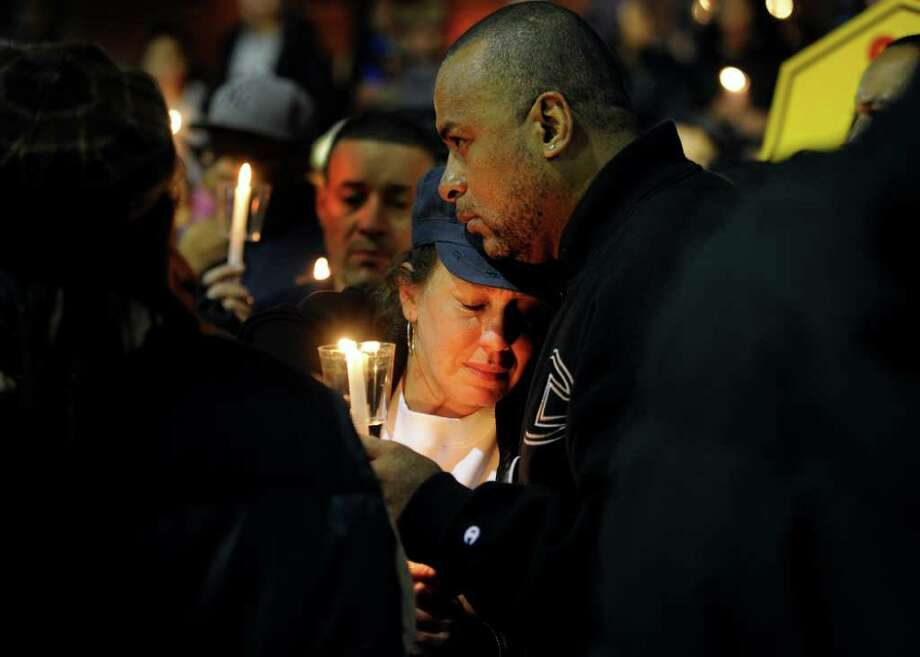 Victoria Padilla, the mother of shooting victim Justin Thompson, is comforted  Wednesday, Jan. 11. 2012 during an anti-violence rally on the steps of City Hall Annex in Bridgeport, Conn.  Hundreds of residents marched from the East End Police Substation on Stratford Avenue to City Hall in response to the shooting of 14-year-old Thompson. Photo: Autumn Driscoll / Connecticut Post