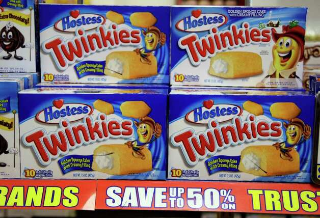 Hostess Twinkies on display at a grocery store in Santa Clara, Calif., Wednesday, Jan. 11, 2012. Hostess Brands Inc., the maker of Twinkies and Wonder Bread, is seeking bankruptcy protection, blaming its pension and medical benefits obligations, increased competition and tough economic conditions. The filing on Wednesday comes just two years after a predecessor company emerged from bankruptcy proceedings. (AP Photo/Paul Sakuma) Photo: Paul Sakuma