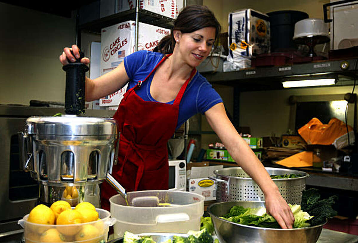 Teresa Piro juices green vegetables in her San Francisco commercial kitchen, where she makes juices, soups, tea and nut milks for her company, Can Can Cleanse. Tuesday; Feb. 1, 2011.
