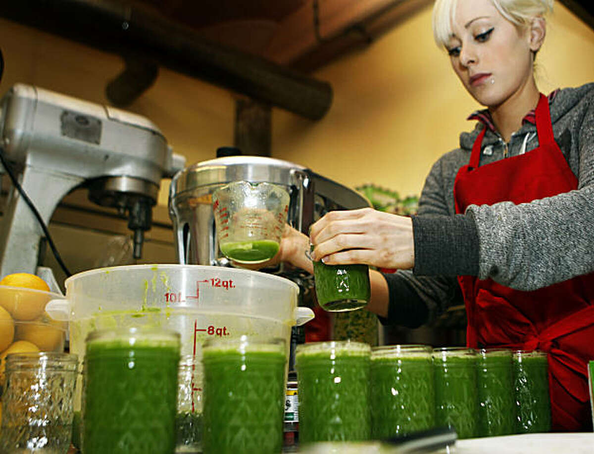 Chef Stephanie Abney fills containers with Teresa Piro's green vegetables juice in Can Can Cleanse, commercial San Francisco kitchen. Tuesday; Feb. 1, 2011.