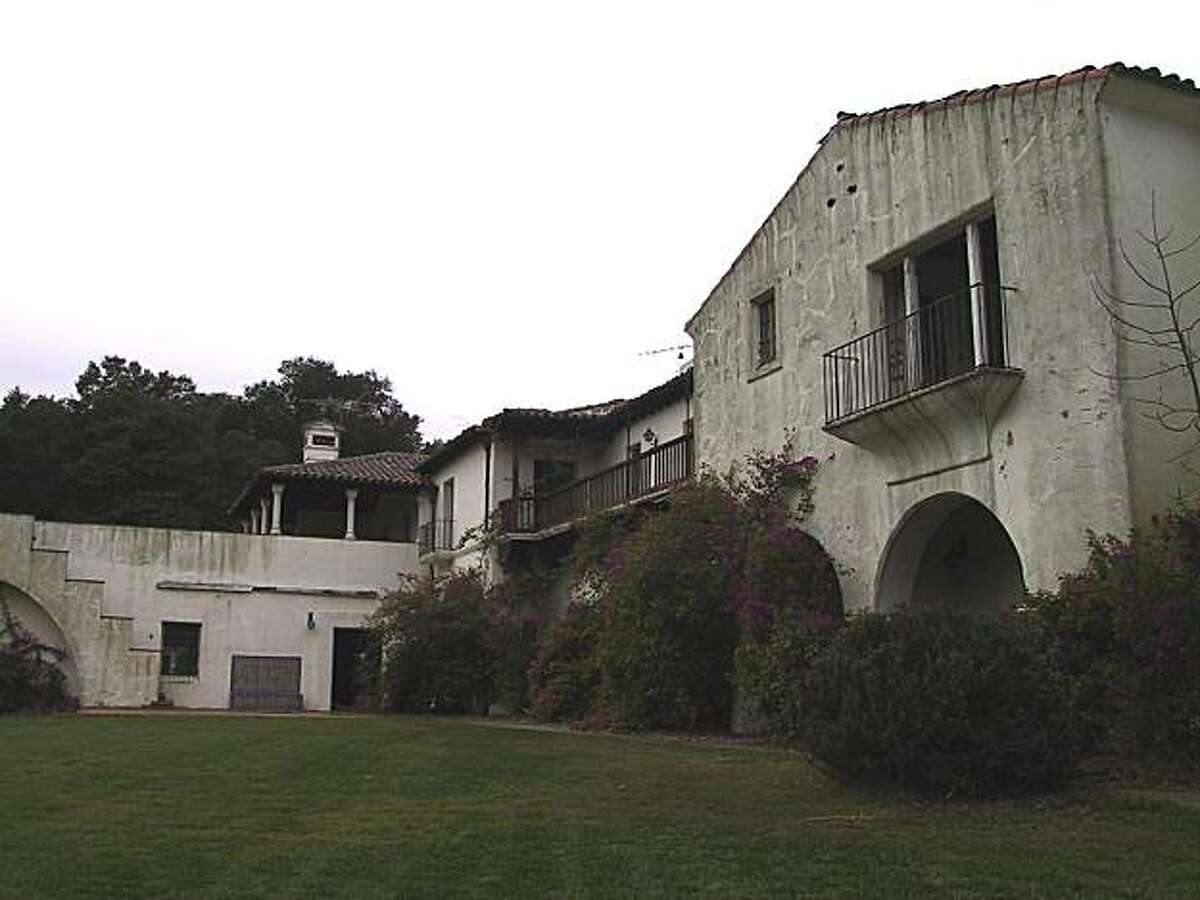The Woodside home owned by Steve Jobs was designed by noted architect George Washington Smith for copper baron Daniel Jackling. Demolition crews began knocking it down Monday.