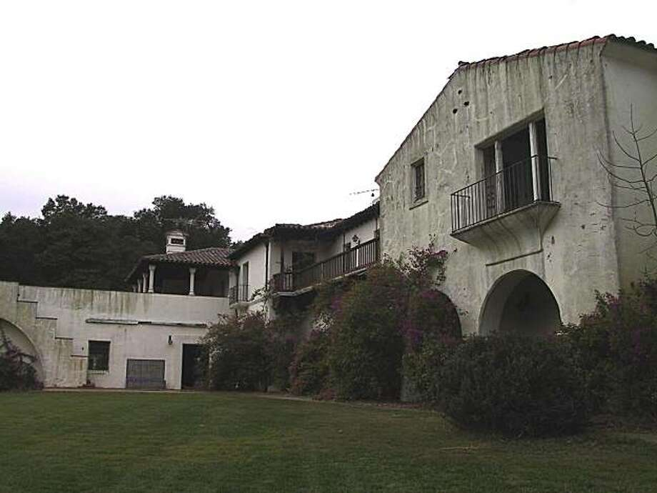 The Woodside home owned by Steve Jobs was designed by noted architect George Washington Smith for copper baron Daniel Jackling. Demolition crews began knocking it down Monday. Photo: Courtesy Of Thalia Lubin