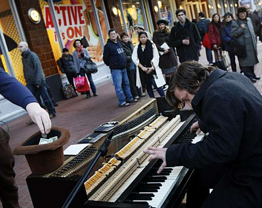 """John """"Thatcher"""" Boomer, hits the keyboards as he and his friend John Morgan not in photo, play their upright Wurlitzer piano for tips on San Francisco's Market Street. Friday Jan 7, 2011 Photo: Lance Iversen, The Chronicle"""