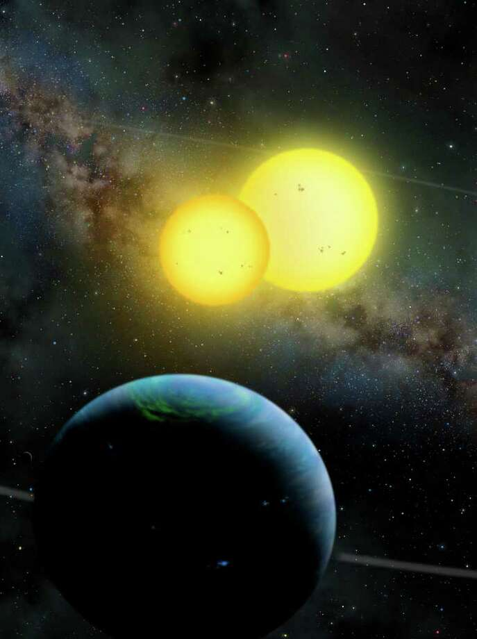 An illustration provided by San Diego State University shows a newly discovered planet, called Kepler 35, that circles not one but two stars. Photo: Lynette Cook / San Diego State University