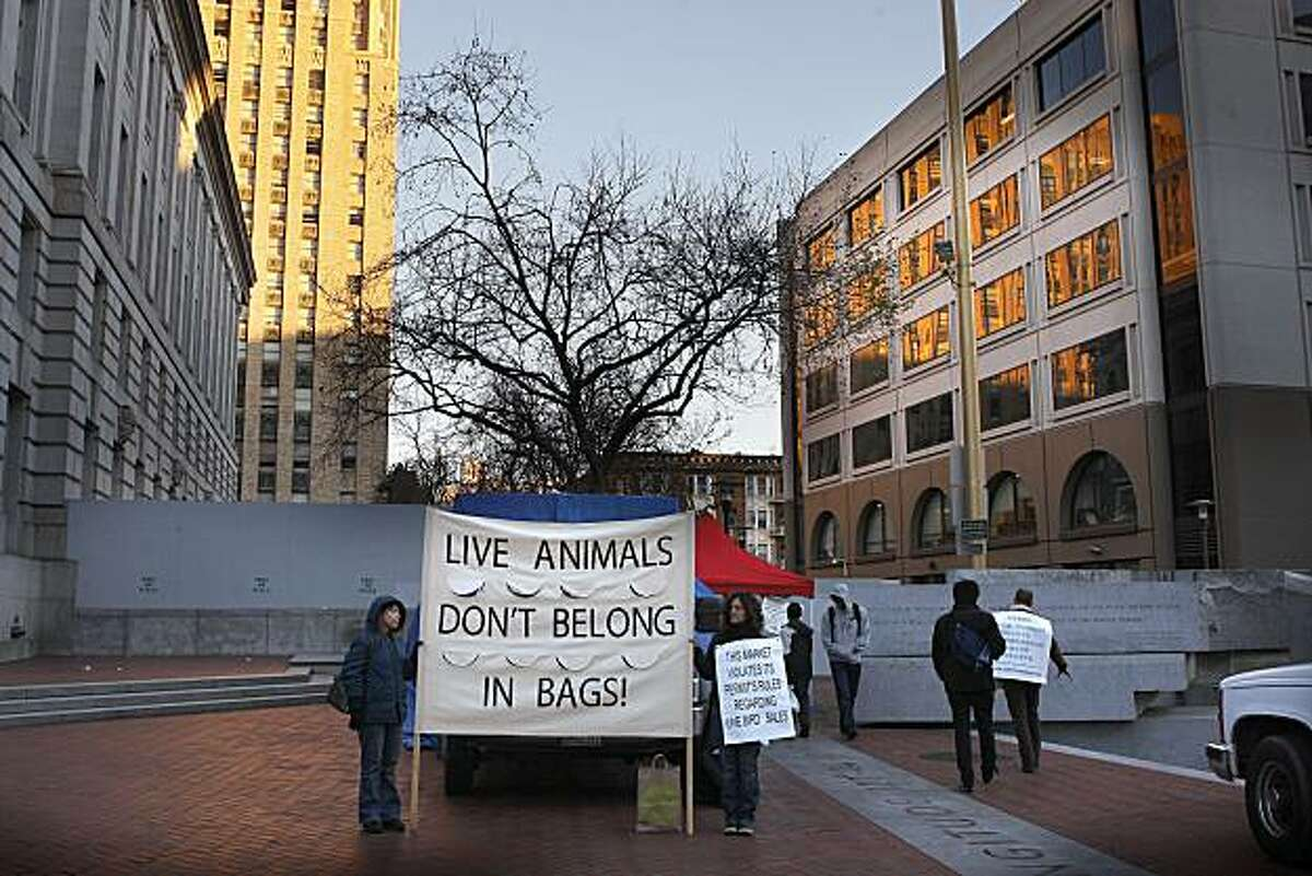 Poultry activists in front of the truck of Raymond Young Poultry at the U.N. Plaza Heart of the City Farmers Market in San Francisco Calif., on Wednesday, February 2, 2011.