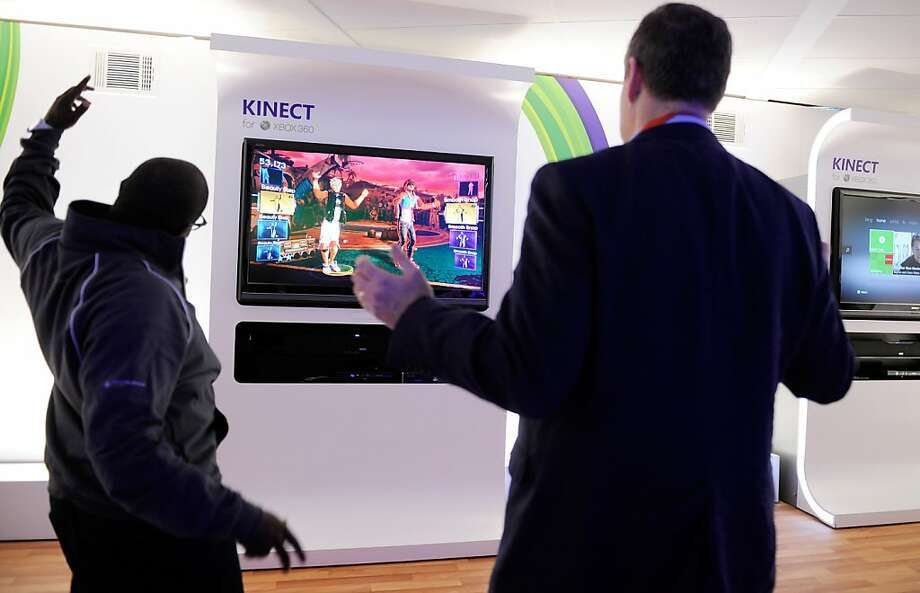 LAS VEGAS, NV - JANUARY 10:  Microsoft representative Derrick Stanfield Kivoi (L) and Bernard Groveman dance to Microsoft's Xbox 360's 'Dance Central 2' using the Kinect at the 2012 International Consumer Electronics Show at the Las Vegas Convention Center January 10, 2012 in Las Vegas, Nevada. CES, the world's largest annual consumer technology trade show, runs through January 13 and is expected to feature 2,700 exhibitors showing off their latest products and services to about 140,000 attendees.  (Photo by David Becker/Getty Images) Photo: David Becker, Getty Images