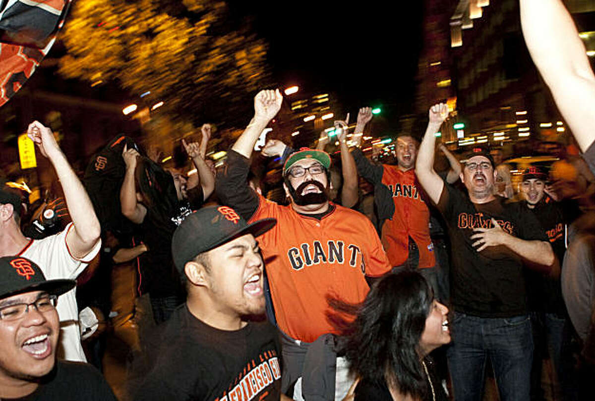 Giants fans celebrate the World Series win outside AT&T Park in San Francisco, Calif., on Monday, November 1, 2010. The Giants beat the Texas Rangers 3-1 in Game 5 of the World Series.