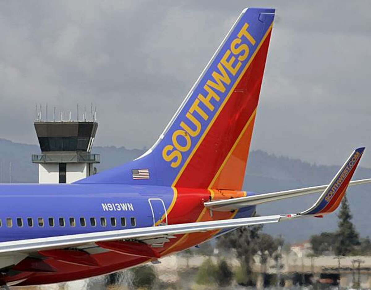 FILE - In this April 23, 2008 file photo, a Southwest plane arrives at San Jose Airport in San Jose, Calif. Southwest Airlines Co. posts a surprisingly large loss Thursday, April 16, 2009, in the first quarter as traffic fell. (AP Photo/Paul Sakuma, file)