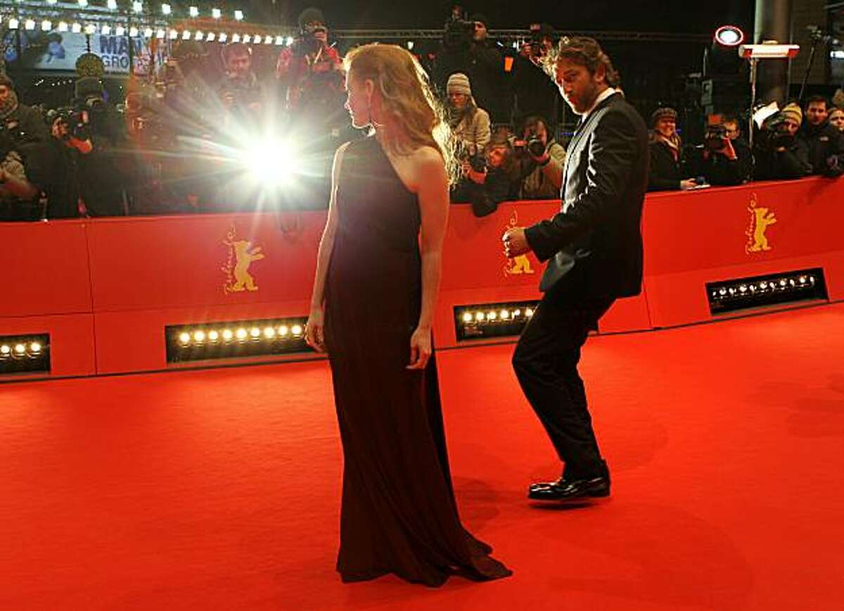 Scottish actor Gerard Butler (L) and US actress Jessica Chastain pose on the red carpet for the premiere of the movie