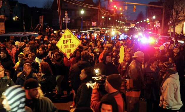 Marchers set off down Stratford Avenue Wednesday, Jan. 11. 2012 during an anti-violence rally through Bridgeport, Conn.  Hundreds of residents marched from the East End Police Substation on Stratford Avenue to City Hall in response to the shooting of 14-year-old Justin Thompson. Photo: Autumn Driscoll / Connecticut Post