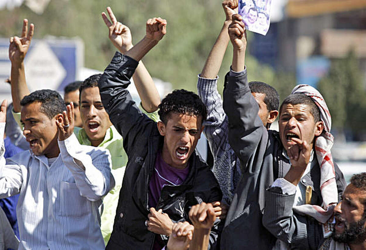 Yemeni anti-government protestors shout slogans during a demonstration demanding political reform and the resignation of President Ali Abdullah Saleh in Sanaa, Yemen, Sunday, Feb. 13, 2011. Yemeni police have clashed with anti-government protesters demanding political reform and the resignation of President Ali Abdullah Saleh. Several thousand protesters, many of them university students, tried to reach the central square in the capital of Sanaa on Sunday, but were pushed back by police using clubs. It was the third straight day of anti-government protests.