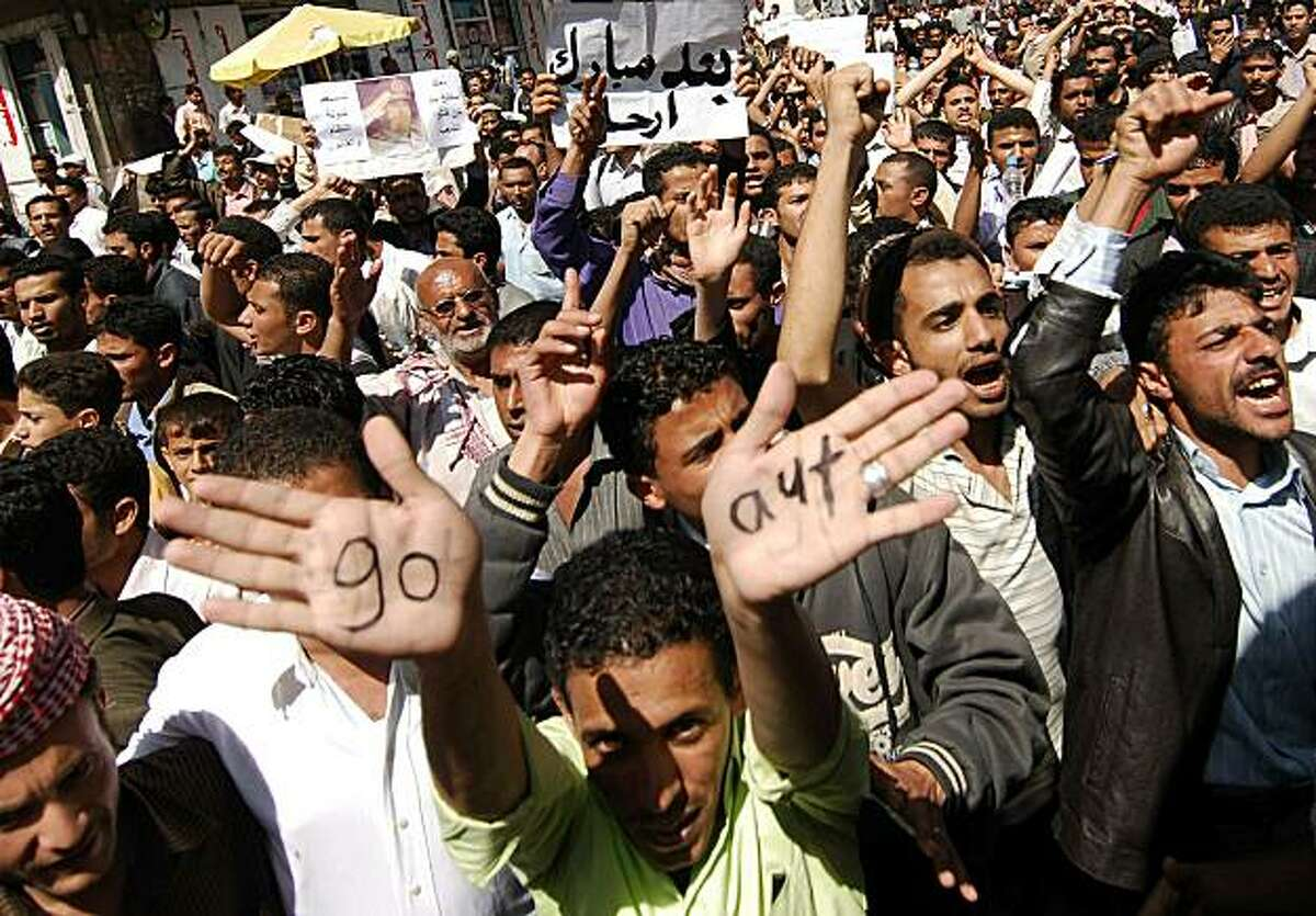 A Yemeni man shows the palms of his hands with the words