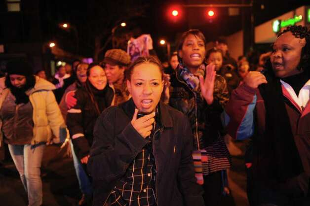 Hundreds of Bridgeport residents participate in an anti-violence rally Wednesday, Jan. 11. 2012  in response to the shooting of 14-year-old Justin Thompson. Photo: Autumn Driscoll / Connecticut Post