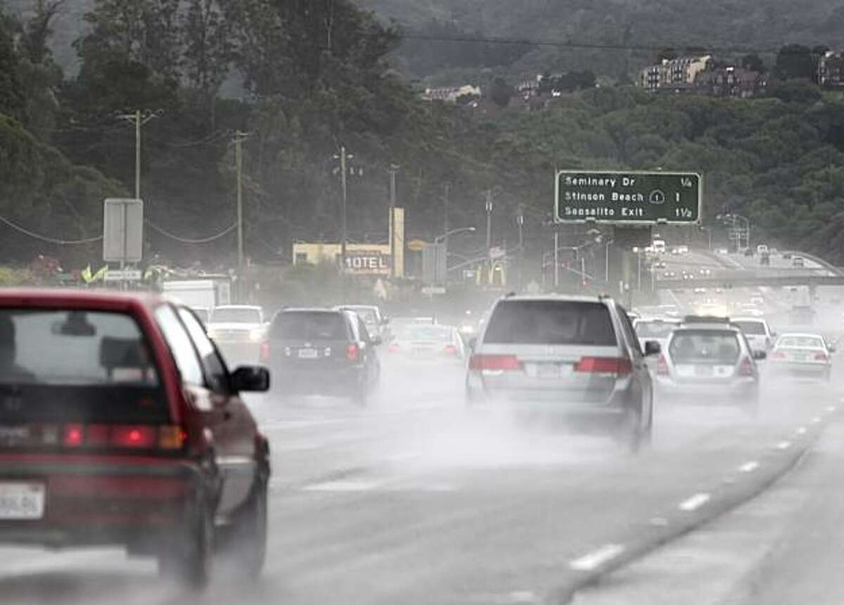 The traffic runs through the heavy rain along the 101 Highway, Thursday Feb. 17, 2011, in Corte Madera, Calif.