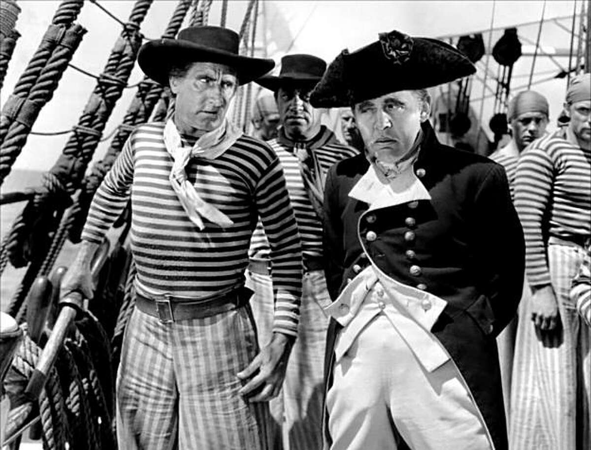 Charles Laughton (right) as Capt. Bligh in
