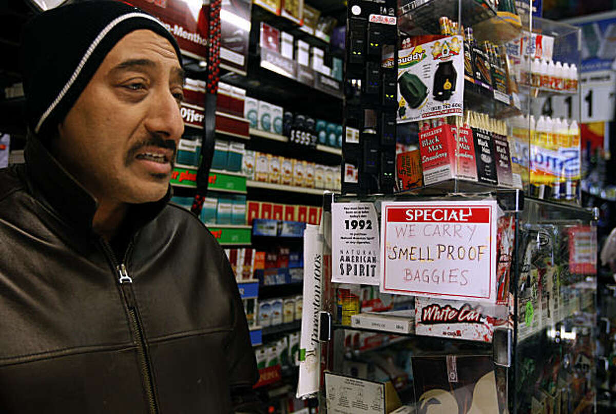 Salih Alkanawi, who owns the Mission Gifts and Tobacco smoke shop, was surprised to hear that city attorney Dennis Herrera filed a lawsuit against his shop, alleging that they continue to sell drug paraphernalia used for smoking crack despite numerous warnings from police officers in San Francisco, Calif., on Thursday, Feb. 17, 2011. Alkanawi says he removed the crack pipes after police ordered him to do so but he continues to sell traditional pipes and bongs.