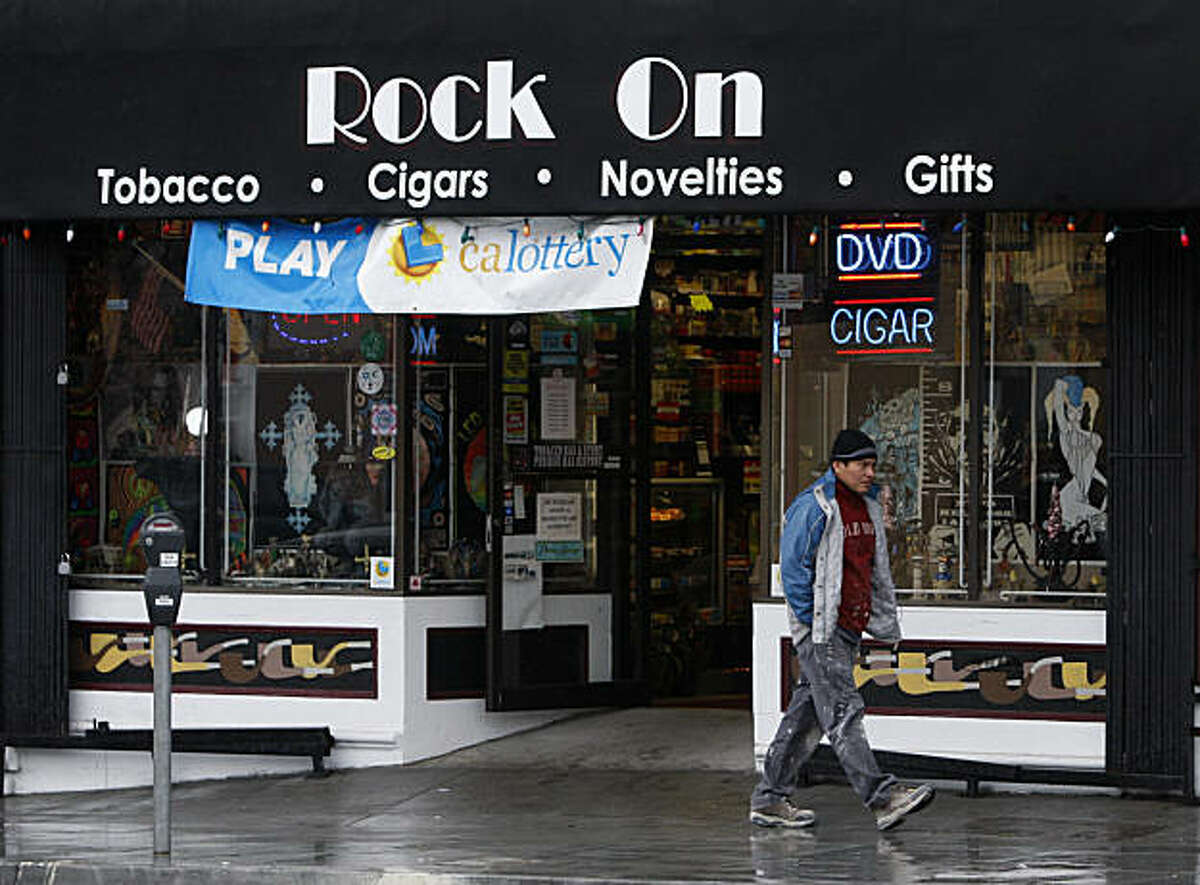 A pedestrian walks past the the Rock On smoke shop in the Excelsior District, after city attorney Dennis Herrera filed lawsuits against six smoke shops, including Rock On, alleging that they continue to sell drug paraphernalia used for smoking crack despite numerous warnings from police officers in San Francisco, Calif., on Thursday, Feb. 17, 2011.